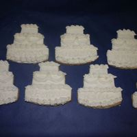 Wedding Cake Cookies  Friend ordered these wedding cake cookies to be used as place cards at a bridal shower. Cookies are covered in fondant that is cut with...