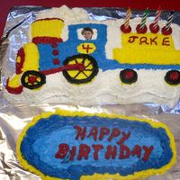 Train This is a cake for a friend's son. He wanted Thomas but she ordered the wrong pan. He liked it anyway.