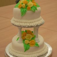 Class 3 Final Cake View1 This is the final cake for class 3. My instructor was wonderful! The cake is orange with buttercream frosting, covered in fondant. The...