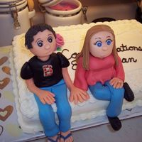 Erica's And Dan's Engagement Cake MMF flowers and characters, buttercream icing.
