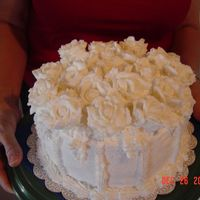 White Roses This is the first cake that I have made after my first class. It is a sour cream pound cake with almond butter cream icing. Filling is...