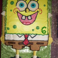 Spongebob Choc. cake with bettercreme frosting, chocolate features (eyes mouth tie). Chocolate dipped pretzels for arms and legs.