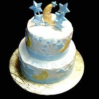 A Star Is Born  Iced in buttercream with fondant moons, stars and ribbon. Topped with white chocolate moon and stars. All decorations dusted with pearl...