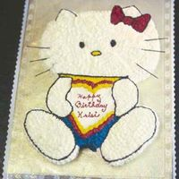 Hello Kitty Carved from an 11x15 sheet cake and iced completely in buttercream. Whiskers are uncooked spaghetti.