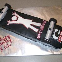 Skateboard An exact replica of the underside of my grandson's skateboard. Wheels are Oreos and chuck, cake top and decals are fondant. Cake iced...