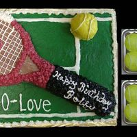 40-Love  Made for a tennis lover. Racquet decorated to look like the one he plays with. Balls are cupcakes. Sheet cake striped like a court surface...