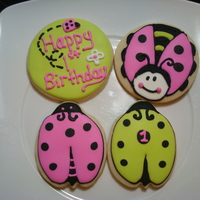 Ladybugs Cookies for a little girl's 1st bday. I made them to match the plates and napkins at her party.