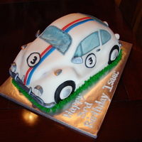 Herbie   The was a chocolate cake covered in MMF and decorated w/ MMF accents.