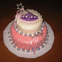 Princess Cake Princess cake with pearls, tiara and wand. Chocolate Fudge with buttercream icing and fondant.