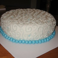 Swirl Cake Practice cake. Spice cake covered with buttercream icing and fondant.