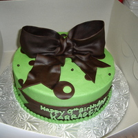 Green And Brown Buttercream with fondant bow and accents.