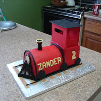 Train Carved train, Buttercream with fondant accents.