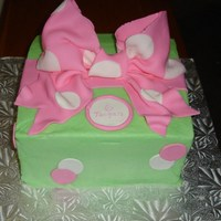 Polka Dot Buttercream with fondant bow.