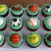 Sports Cupcakes... I did these for a little boys 2nd B-day, he loves sports.... chocolate cakes w/ buttercream frosting and fondant decorations.TFL!!