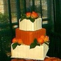"Bridal_Show_Cake_Cropped.jpg Fondant covered styro cake. Real flowers & leaves. This was a ""dummy cake"" at a bridal show I participated in erlier this..."