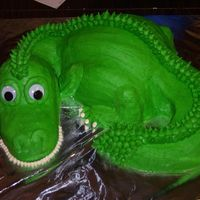 Dragon / Dinosaur Cake Cake I made for my good friends 4th birthday. He was really into dinosaurs at the time. He just loved it.