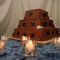 My Wedding Cake Chocolate Buttercream with dark chocolate molded stars. Top layer is Lemon cake with lemon filling, middle layer is Dark Chocolate Fudge...