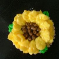 Sunflower Cupcake The sunflower petals were done in buttercream with a leaf tip.