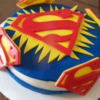 Superman Cheesecake i made sure the cheesecake was extra firm before covering it w/ fondant