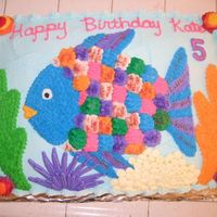 "Rainbow Fish Cake Decorations are chocolate and buttercream. The scales are vanilla wafers decorated with buttercream so the birthday girl could give ""..."