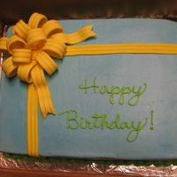 Present With A Bow The bow and ribbon is fondant.