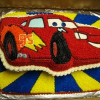 Lightning Mcqueen This was for a 1 year old's birthday. The parents wanted to be able to lift off the car to give to the baby, and serve the half sheet...