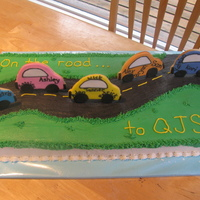 On Your Way... This is a graduation cake I did for grade 7 students moving onto junior school. The cars are sugar cookies with the students names printed...
