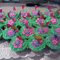 Butterflies & Flower Cupcakes I made these to go along with the Sun & Flowers first birthday cake I posted a few days ago. The flowers are Marshmallow fondant and...