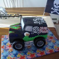 Grave Digger I did this for my son's 7th birthday. He loves Grave Digger! It's a yellow cake, decorated in all buttercream, except for the...