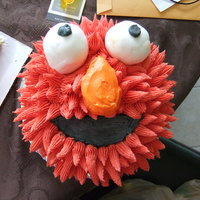 "Elmo Smash Cake Just a 6"" cake with buttercream & fondant eyes...I think Elmo looks a wee bit possessed lol!"