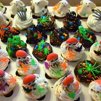 House Warming - Halloween Cupcakes Pictured are 3 dozen mixed cupcakes (strawberry, classic vanilla, fudge-type/dark chocolate) cupcakes for a friend's house warming a...