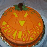 Jack O'-Lantern Jacko-o'-lantern cake. Cake is red velvet but the color orange with bc incing the family name is in the smile (Hollander) This was fun...