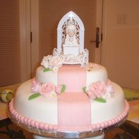Kiana's 1St Communion White cake with buttercream frosting and raspberry filling. All decorations were made with MMF. The 1st communion figurine was stored...