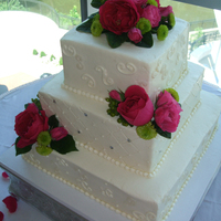 Patterson Wedding Three square tiers in buttercream with piping and diamond pattern, fresh flowers provided by bride. Thanks for looking.