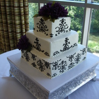 Damask Cake For Kidd Wedding Hand piped damask desing on square cake with lapis colored silk flowers provided by bride.