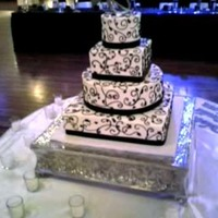 "Wright Wedding Alternating rounds and squares, free hand scrollwork/piping in black buttercream. Sizes are 5"" Rnd, 7"" Sq, 12"" Rnd, 15""..."