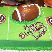 Georgia Bulldog Football Birthday Cake My client's young son LOVES UGA. So I did a yellow butter cake with a simple green background. And then a carved chocolate butter cake...
