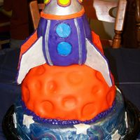 "Rocket Ship Birthday Cake This is the rocket ship cake I did for my son's 4th Birthday party. The base is a vanilla butter cake, the middle ""planet""..."