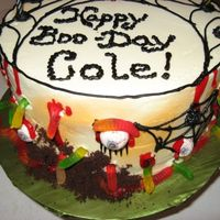 Happy Boo-Day! Side View. This was a cake I did for a 7 year old boy who wanted a Halloween themed cake. Everything is edible. Side view of the same cake.