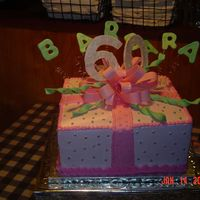 60Th Birthday Cake This is a marble cake iced with buttercreme frosting. It has fondant and gumpaste accents.