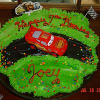 Cars Cupcake Cake I made this Cars cupcake cake for my sons birthday party. All the kids liked it.