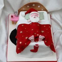 Sleeping Santa Rectangular fruit cake covered in marzipan and fondant, all decorations made from modelling paste and hand painted.