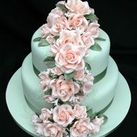 Peachy Green Wedding Cake This is the first two tiers of a wedding cake, which also has an identical cake, minus the roses and ribbon as a cutting cake, because the...