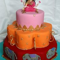 Bollywood Birthday Cake This is a caramel mud and two tiers of white coconut mud cake(both Boonenati's recipes) covered in ganache and Fondx. The Lakshmi on...