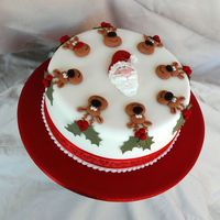 Santa And His Reindeer An 8 inch fruitcake which is being donated to a local scout group to raise money for their Jamboree.Santa and the reindeer are made with...