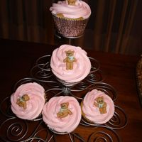 Teddies Cupcakes Vanila cupcake filled with raspberry ganache and covered with raspberry buttercream. teddy made of sugar.