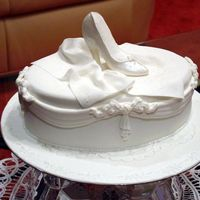 Shoe Engagement Cake All white and pearl. White Chocolate mudcake, Shoe made with sugarpaste.