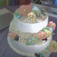 Seashells Buttercream icing with gumpaste flowers, chocolate sea shells and candy stones