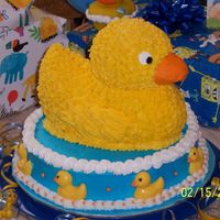 3D Ducky Cake This 3D birthday cake was for my son's first birthday. It was my first personal cake after finishing my cake class! The small duckies...