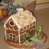 Gingerbread House A side view - those stained glass windows caused some problems when I baked them and let them cool without parchment or silpat underneath!...